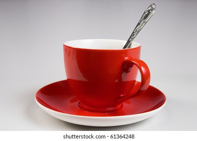 red cup with tea spoon (series)