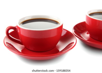 Red cups of strong coffee close up