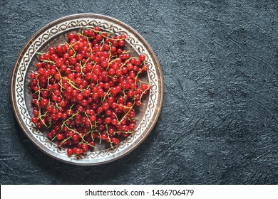 red currant berries in a ceramic bowl top view. red currant flat lay. background with red currant.