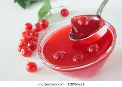 Red currant jelly with berries in a bowl