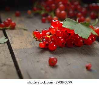 Red currants on a wooden background