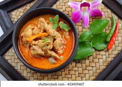 Red curry with pork is Thai food.