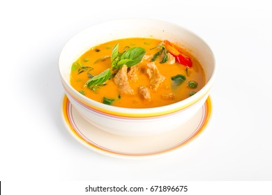 Red curry with pork,spicy curry coconut milk on white background