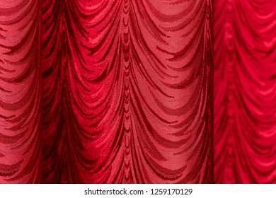 Red curtain as abstract background .