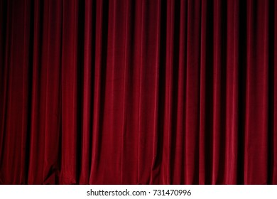 Red Curtain close before theatre drama begin and lighting shade of color and dark drapes fold background