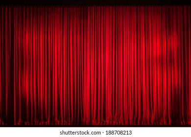 Red curtain closed on the stage of opening night