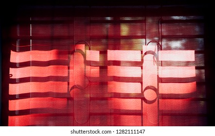 Red curtain clothes of a window isolated object photo