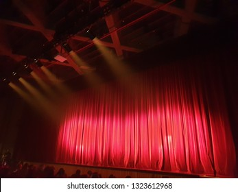 Red curtain on empty stage before performance begins