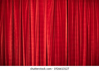 Red curtain in theatre. Textured background