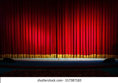 Red curtains in a theater scene of the show. Closed theater curtain of red velvet, texture, background.