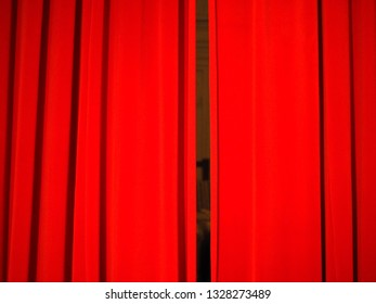 red curtains in a theatre useful as a background
