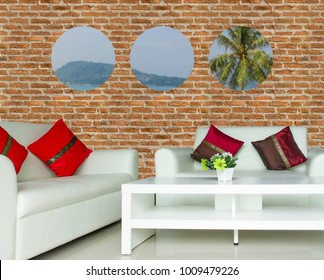 red cushions on white sofa in living room with circle windows nature view