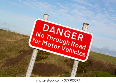 Red Danger, No Through Road for Motor Vehicles Sign