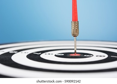 Red dart arrow hit target point center and blue background , winner success vision concept