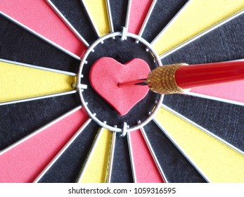 Heart bullseye images stock photos vectors shutterstock a red dart arrow hitting on heart shaped at bullseye of dartboard for reaching target altavistaventures Images