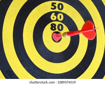 Heart bullseye images stock photos vectors shutterstock a red dart arrow hitting on center at bullseye of dartboard which is heart shaped altavistaventures Images