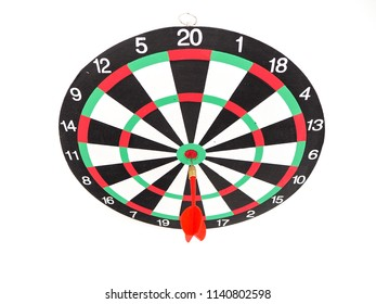 Red dart arrow hitting in the target center of dartboard, Business goal concept.