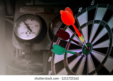 Red dart arrow hitting in the target center of dart bard, winner the goal of victory concept, Sluggish business, we do not stop seeking in formation for success