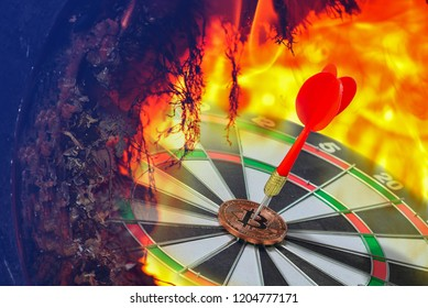 Red Dart embroiders on bitcoin, Right on target concept using dart in the bulls eye on dartboard business success hot springs concept fierce competition on fire background