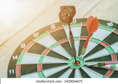 Red dart hitting on dartboard, Concept of challenge in business marketing bulls and intelligent customer reaching, the dart is the strategy or skill, the dartboard in target or goal retro filter.