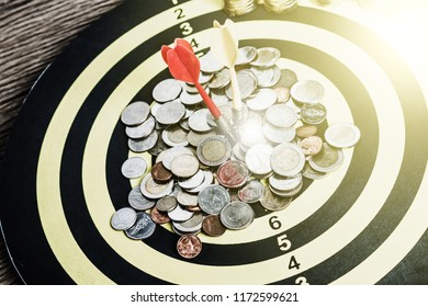 Red dart on board right direction hit target goal. Money finance investment plan focus on achievement with smart thinking accurate strategy. Outstanding perfect performance with concentrate concept