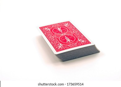 A red deck of cards against a white background