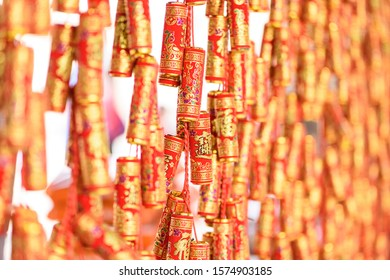 "red decorative firecracker decorated for the traditional Chinese Spring Festival(Chinese New Year), the  Chinese characters on it which mean ""bring in fortune and treasure"""