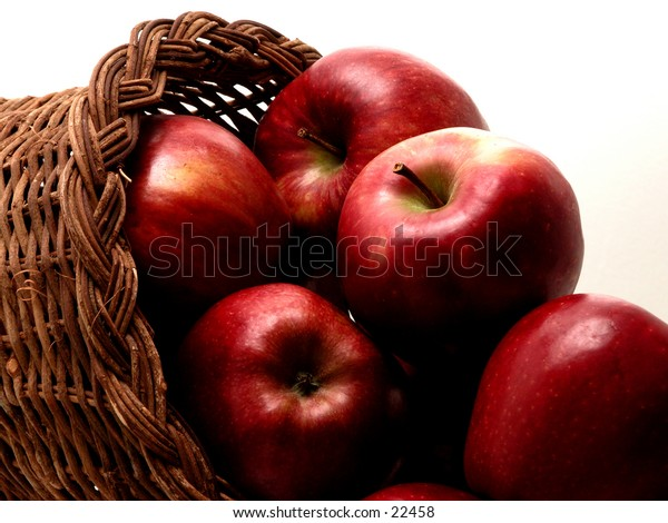 Red delicious apples in a wicker basket.