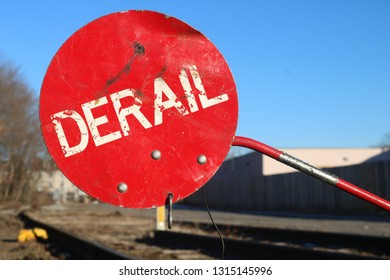 Red derail sign on old railroad tracks