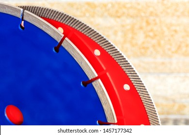 Red diamond circle for granite and stone, blue for concrete, reinforced concrete against a background of orange-gold sandstone wall.