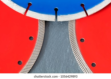 Red diamond wheels for granite and stone, blue for concrete, reinforced concrete, on a slab of gray sandstone stone