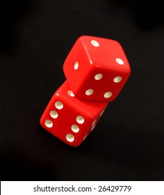 Red dice and black background