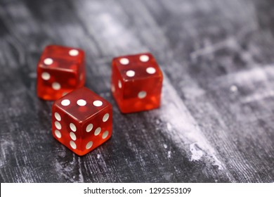 Red dice on vintage wooden table. Background for casino games, gambling, luck or randomness
