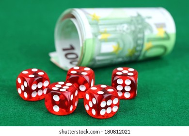 Red dices and money, on green background