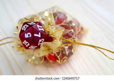 Red dices for rpg, board or tabletop games in yellow transparent bag (pouch).