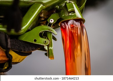 red diesel being poured into a container in a steady stream