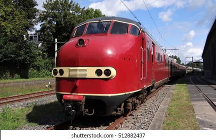 A red diesel train by de Dutch railway museum in Utrecht
