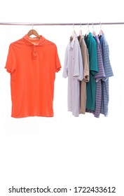 Red and different striped shirts background of many clothes hang with hanger in wardrobe