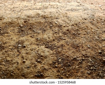 Red dirt ground with stone texture