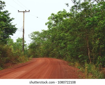 red dirt road in countryside