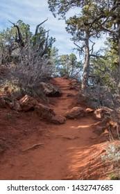 Red Dirt Trail Heading Uphill through Utah desert