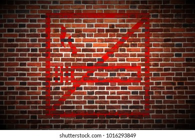 red dont smoke sign painted on red brick wall texture background