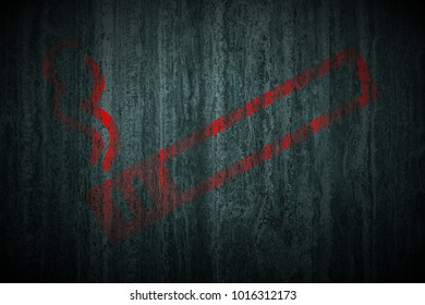 red dont smoke sign painted on green marble stone texture background