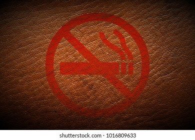 red dont smoke sign painted on brown leather texture texture background