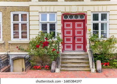Red door at a historic house in Gluckstadt, Germany