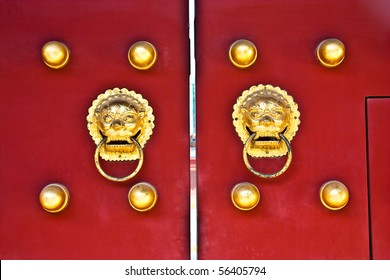 Red door in hutong area, close to Forbidden City, Beijing, China