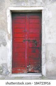 Red door in the island of Giudecca in Venice