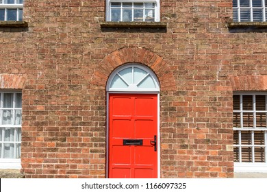 Red Door On Red Brick House, Facade in Georgian Style, Central Front View Taunton Somerset Summer 2018
