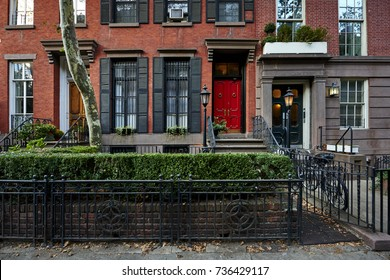 a red door on a colorful brownstone building