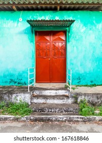 Red Door on Turquoise Stucco Home